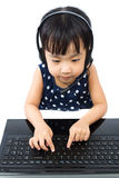 Asian Little Chinese Girl in Headset with Laptop Stock Images