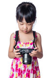 Asian Little Chinese girl holding a camera Royalty Free Stock Photo
