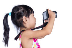 Asian Little Chinese girl holding a camera royalty free stock images