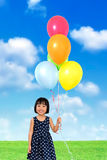 Asian Little Chinese Girl Holding colorful balloons Royalty Free Stock Photo