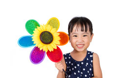 Asian Little Chinese Girl Holding Colorful Windmill Stock Photo