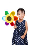 Asian Little Chinese Girl Holding Colorful Windmill Royalty Free Stock Photos