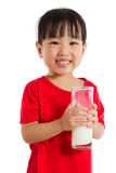 Asian Little Chinese Girl Holding a cup of Milk Royalty Free Stock Photo