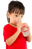 Asian Little Chinese Girl Holding a cup of Water Stock Photo