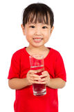 Asian Little Chinese Girl Holding a cup of Water Royalty Free Stock Images