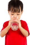 Asian Little Chinese Girl Holding a cup of Water Royalty Free Stock Photos