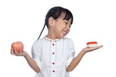 Asian Little Chinese Girl holding Donut and apple Stock Photography