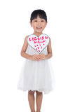 Asian Little Chinese Girl holding greeting card for mother`s day. In isolated white background Royalty Free Stock Photography