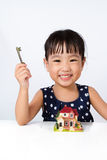 Asian Little Chinese Girl Holding Key for Property Concept Royalty Free Stock Photography
