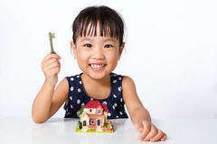 Asian Little Chinese Girl Holding Key for Property Concept Royalty Free Stock Photos
