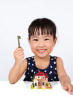 Asian Little Chinese Girl Holding Key for Property Concept Stock Images