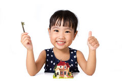 Asian Little Chinese Girl Holding Key for Property Concept Stock Photography