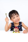 Asian Little Chinese Girl Holding Key for Property Concept Royalty Free Stock Images