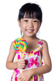 Asian Little Chinese girl holding lollipop Stock Images