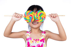 Asian Little Chinese girl holding lollipop Royalty Free Stock Image