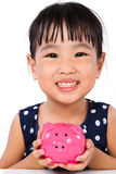Asian Little Chinese Girl Holding Piggy Bank Stock Photos