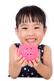 Asian Little Chinese Girl Holding Piggy Bank Royalty Free Stock Photos