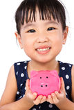 Asian Little Chinese Girl Holding Piggy Bank Stock Photo