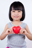 Asian Little Chinese Girl Holding Red Heart Stock Photo