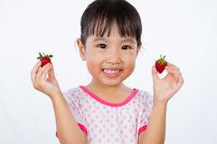 Asian Little Chinese Girl Holding Strawberry Royalty Free Stock Photography