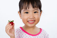 Asian Little Chinese Girl Holding Strawberry Royalty Free Stock Photo