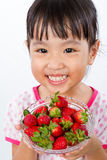 Asian Little Chinese Girl Holding Strawberry Stock Photo