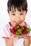 Asian Little Chinese Girl Holding Strawberry Stock Image