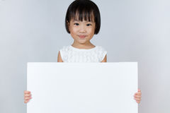 Asian Little Chinese Girl Holding a White Blank Royalty Free Stock Photos