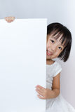 Asian Little Chinese Girl Holding a White Blank Royalty Free Stock Images