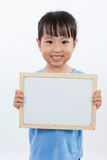 Asian Little Chinese Girl Holding a Whiteboard Stock Photography
