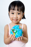 Asian Little Chinese Girl Holding a World Globe Stock Photo