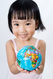 Asian Little Chinese Girl Holding a World Globe Royalty Free Stock Image