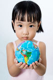 Asian Little Chinese Girl Holding a World Globe Stock Photography