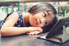 Asian Little Chinese Girl Looking at Digital Tablet Stock Images
