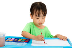 Asian Little Chinese Girl Painting with Brush Stock Photography
