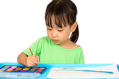 Asian Little Chinese Girl Painting with Brush Stock Images