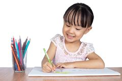 Asian Little Chinese girl painting on paper Royalty Free Stock Photos