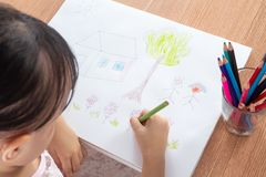 Asian Little Chinese girl painting on paper Stock Photography