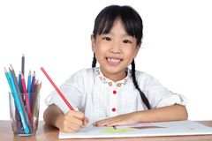 Asian Little Chinese girl painting on paper Royalty Free Stock Image
