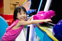 Asian Little Chinese Girl Playing Arcade Game Machine Stock Photo