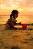 Asian Little Chinese Girl Playing with Beach Toys Stock Photo
