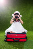 Asian Little Chinese girl playing with camera Stock Photos