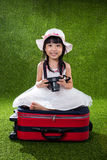 Asian Little Chinese girl playing with camera Royalty Free Stock Photography