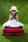 Asian Little Chinese girl playing with camera Stock Photo