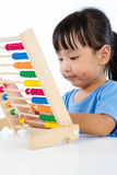 Asian Little Chinese Girl Playing Colorful Abacus Stock Photography