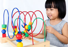 Asian Little Chinese Girl Playing Colorful Educational Toy Stock Images