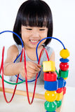 Asian Little Chinese Girl Playing Colorful Educational Toy Stock Photography