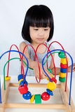Asian Little Chinese Girl Playing Colorful Educational Toy Stock Photos