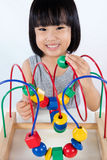 Asian Little Chinese Girl Playing Colorful Educational Toy Royalty Free Stock Photography
