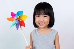 Asian Little Chinese Girl Playing Colorful Pinwheel Stock Photo